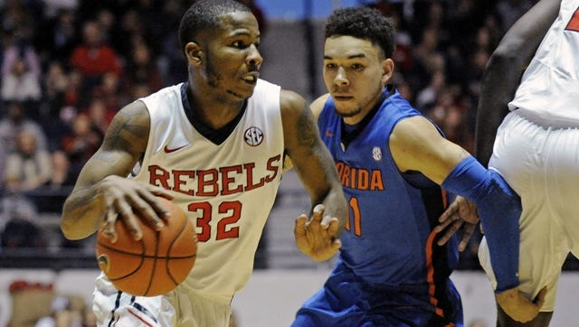 Mississippi guard Jarvis Summers (32) drives past Florida guard Chris Chiozza (11) during the first half of an NCAA college basketball game in Oxford, Miss., Saturday, Jan. 24, 2015. (AP Photo/The Daily Mississippian, Thomas Graning)