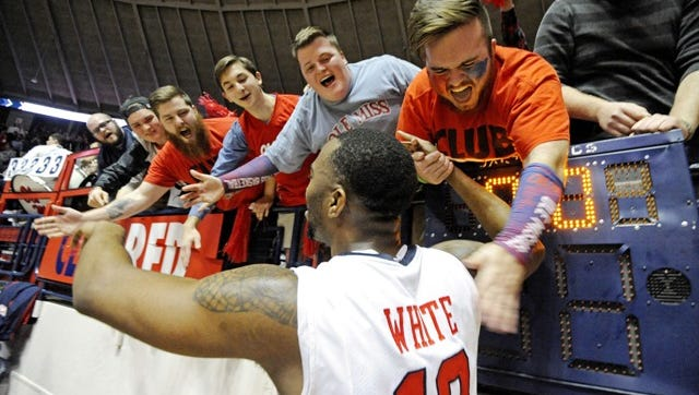 Mississippi guard Ladarius White celebrates with fans after an NCAA college basketball game against Florida in Oxford, Miss., Saturday, Jan. 24, 2015. Mississippi won 72-71. (AP Photo/The Daily Mississippian, Thomas Graning)