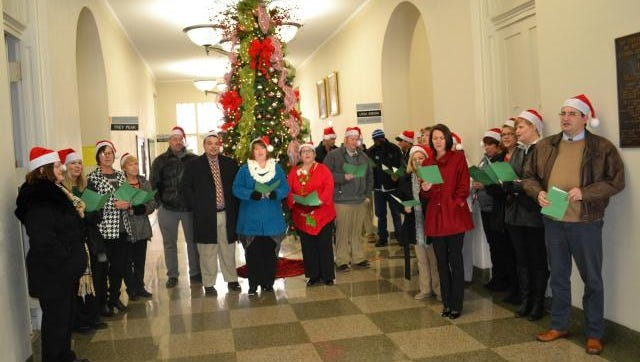 Several member of the Union County School District staff took time from their December 19 Christmas luncheon to carol at several local businesses.  Here the carolers entertain folks at the Union County Courthouse.  The singing was joyful and much appreciated.