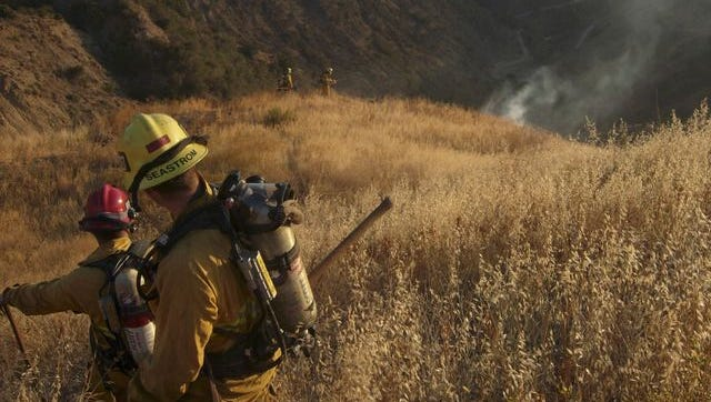 This photos from 2008 shows Ventura County firefighters monitoring a hot spot on a mountain overlooking Fillmore.