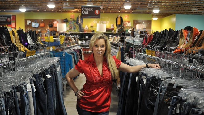 Hillary Schieve, seen here in a 2013 file photo, is the owner of Plato's Closet and Clothes Mentor.