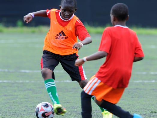 David Akinsanya, 11, works the ball upfield against a Park View defender during the Spring Classic held at the RFK Auxiliary field.