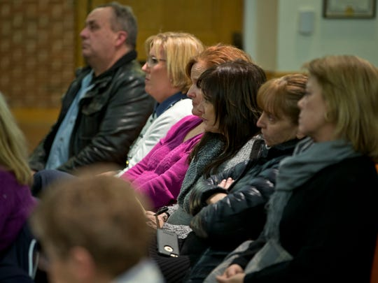 Concerned residents listen to officials comments. Toms
