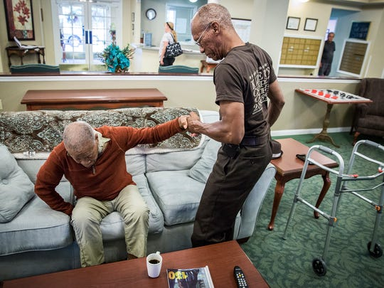 Carl Kizer Jr. has his daily visit with his father at Lynd Place Nursing Home Thursday afternoon.