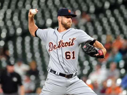Tigers pitcher Shane Greene (61) throws a pitch in