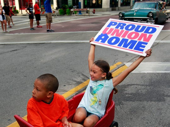 Cousins Tyson Coleman and Victoria Coleman show their union pride in Milwaukee's Laborfest parade.