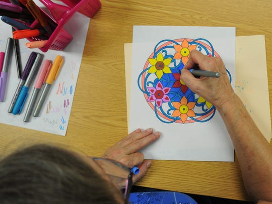Karin Mansfield participates in her first coloring