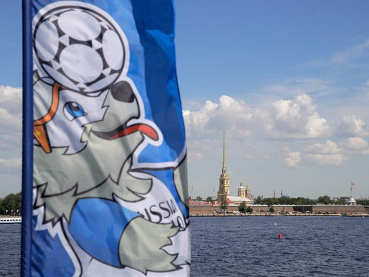 Zabivava, the Official Mascot for the 2018 FIFA World Cup Russia is shown on a waving flag, prior to the Confederations Cup, Group A soccer match between Russia and New Zealand, in St. Petersburg, Russia, Saturday, June 17, 2017. (AP Photo/Pavel Golovkin)