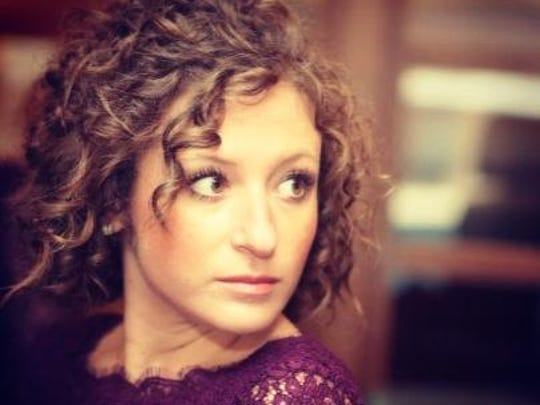 """""""They say curly-haired girls are the most fun. In Erika's case, it's true,"""" says Erika Evans' nominator."""