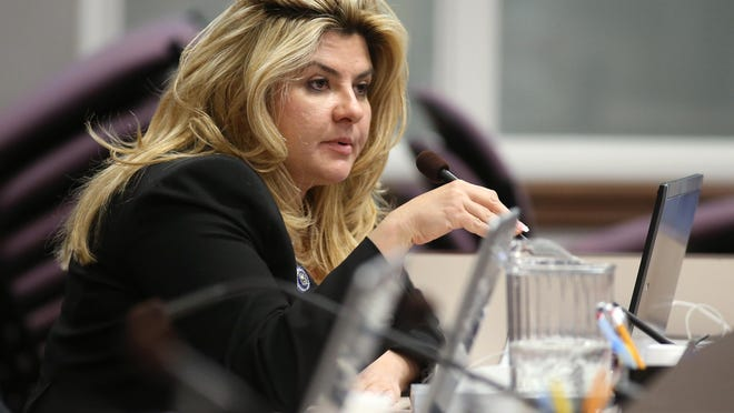 Michele Fiore works in committee during the final day of the 77th Legislative session at the Legislative Building in Carson City in 2013.