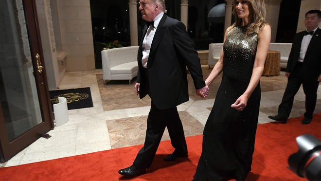 President Donald Trump and First lady Melania Trump attend a New Year's Eve celebration at Mar-a-Lago.