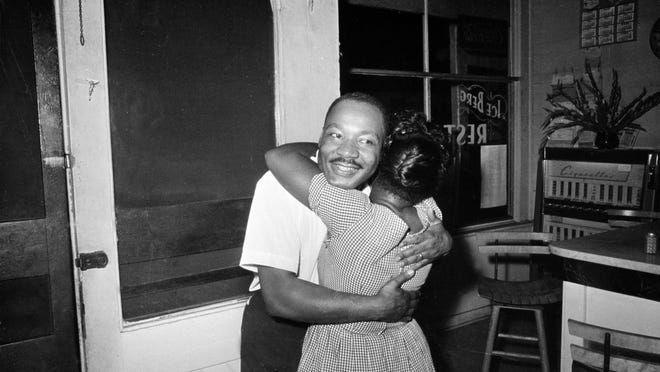 The Rev. Dr. Martin Luther King Jr. is hugged by Lennette Pembleton in St. Augustine after learning that the U.S. Senate passed the Civil Rights Act on June 19, 1964.
