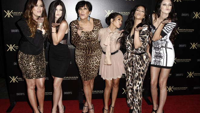 """In this Aug. 17, 2011 file photo, from left, Khloe Kardashian, Kylie Jenner, Kris Jenner, Kourtney Kardashian, Kim Kardashian and Kendall Jenner arrive at the Kardashian Kollection launch party in Los Angeles. After more than a decade, """"Keeping Up With the Kardashians"""" is ending its run."""