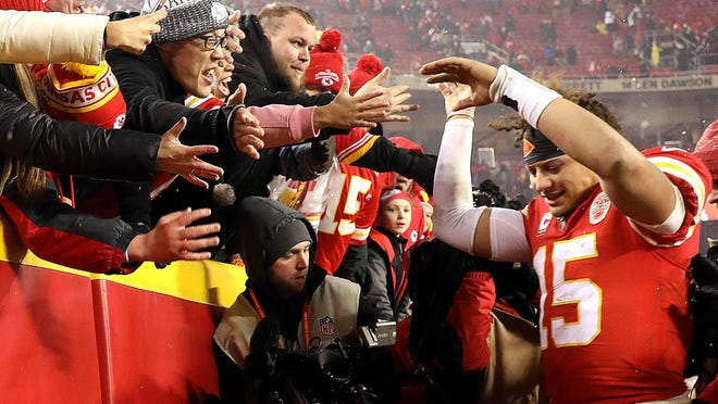 Kansas City Chiefs quarterback Patrick Mahomes (15) celebrates with fans after a playoff win against the the Indianapolis Colts at Arrowhead Stadium in Kansas City, Mo., on January 12, 2019.