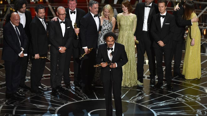 "Alejandro G. Inarritu, center, and the cast and crew of ""Birdman or (The Unexpected Virtue of Ignorance)"" accept the award for the best picture at the Oscars last month in Los Angeles."