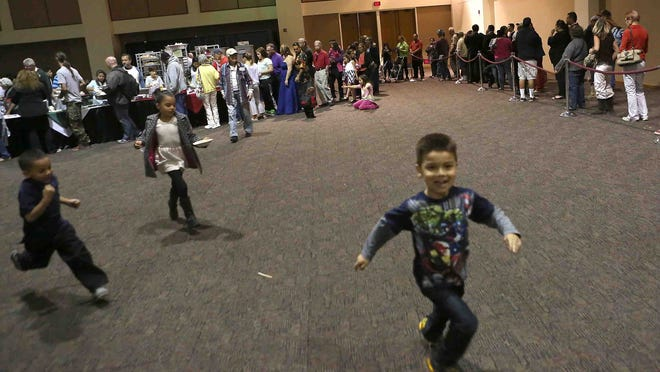 Children run around during the Christmas at the Palm Springs Convention Center event, Thursday.