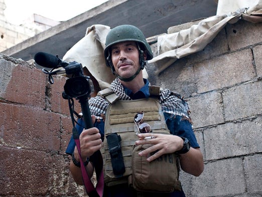 In this November 2012 photo posted on the website freejamesfoley.org, journalist James Foley covers the civil war in Aleppo, Syria.