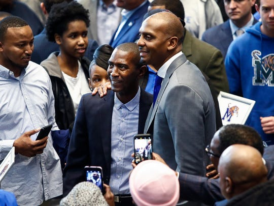 "Anfernee ""Penny"" Hardaway smiles while taking a picture with former Tiger great Elliot Perry (left) after introduced as the University of Memphis' new head basketball coach at the Laurie-Walton Family Basketball Center Tuesday morning. Hardaway, who a standout player at the U of M from 91-93, will take over for recently fired head coach Tubby Smith."
