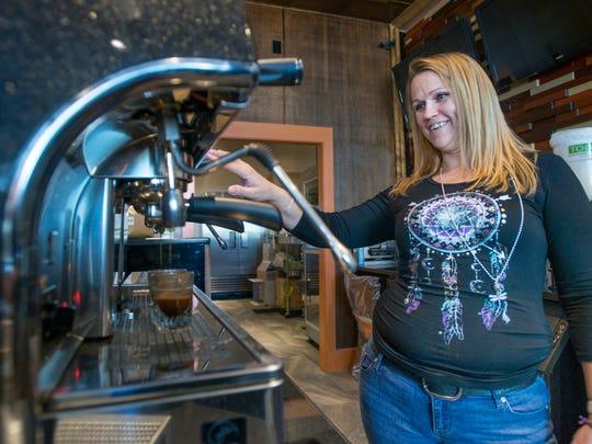 Owner Kierstyn Hussin makes espresso at Mido's coffee