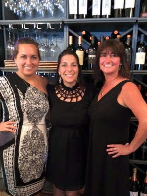 Maureen Bayer, Via Girasole owner Nicole Casciani McLean and staff member Susan Matuck at the wine bar's grand opening in late July.