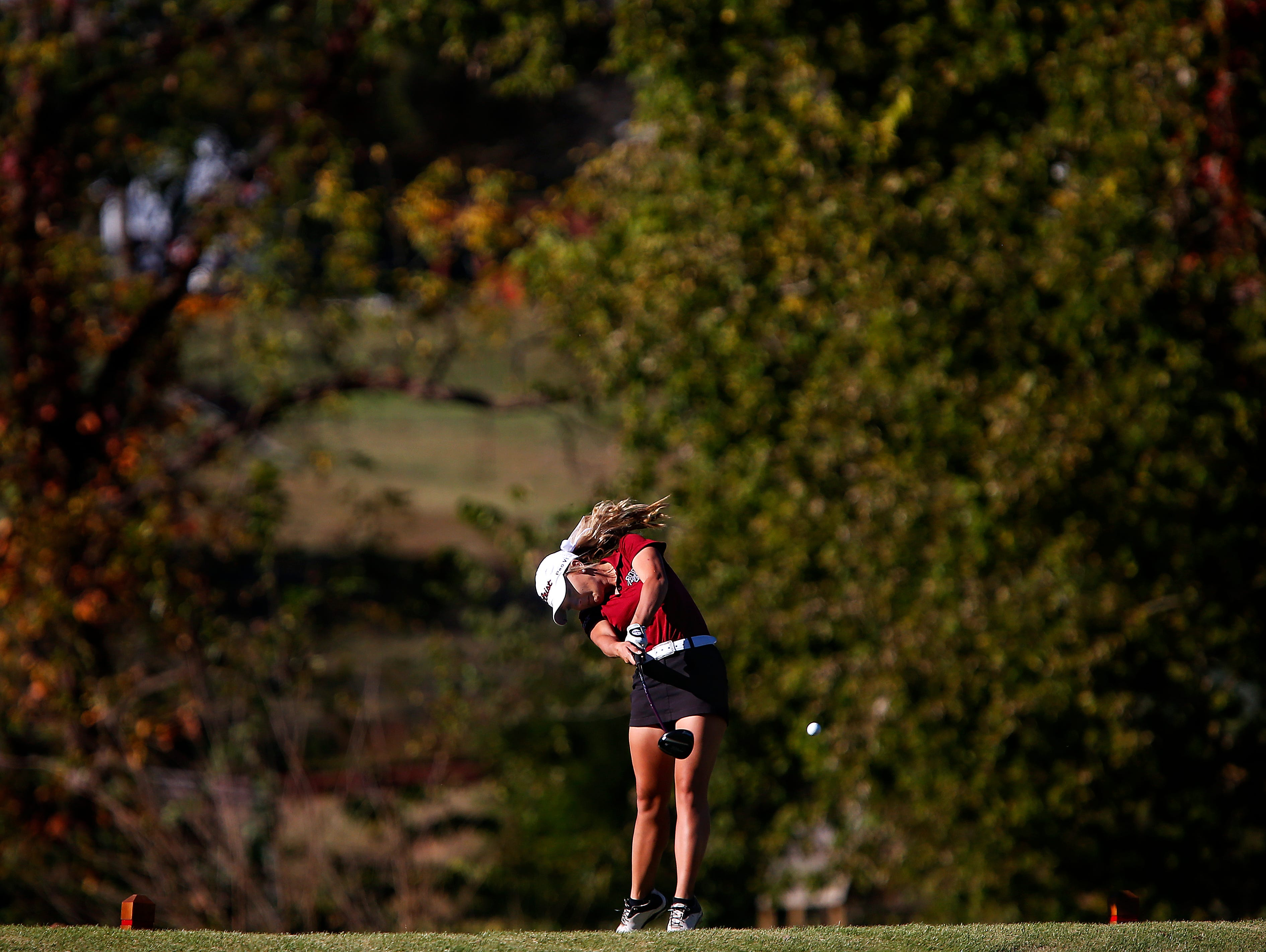 Warrensburg High School golfer Taylor BeDell tees off from the 18th hole during the 2015 MSHSAA Class 2 Girls Golf State Championship played at Rivercut Golf Club in Springfield, Mo. on Oct. 13, 2015. BeDell barely avoided a playoff with Kickapoo's Ari Acuff after Acuff missed an eagle putt on the 18th to give BeDell the state title.
