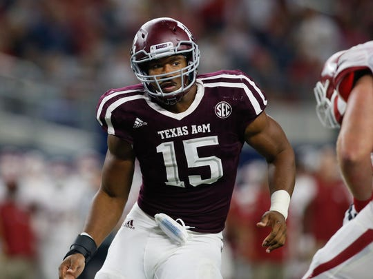 Texas A&M Aggies defensive lineman Myles Garrett (15) is shown in game action against Arkansas on Sept. 24. Garrett is expected to be the first selection in the NFL draft.