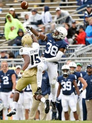 Penn State's Lamont Wade breaks up a pass intended