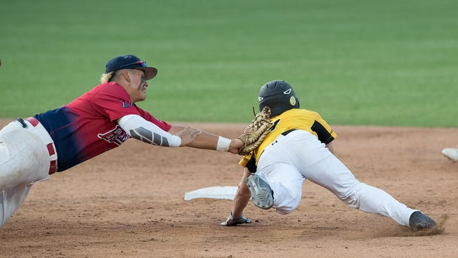 Veterans Memorial's Daylan Pena dives to tag out Forney's Ryland Kerby as he runs to second base during the third inning of the 5A State Baseball Semifinal at Dell Diamond in Round Rock on Thursday, June 7, 2018.