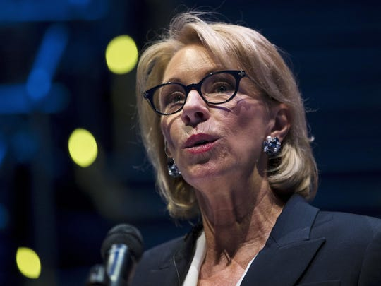 In this Sept. 17, 2018 file photo, Education Secretary Betsy DeVos speaks during a student town hall at National Constitution Center in Philadelphia. President Donald Trump's school safety commission is proposing a rollback of Obama-era guidance that was meant to curb racial disparities in school discipline. The commission was led by DeVos and made dozens of policy recommendations in a report released Tuesday. Trump created the panel in March following the deadly school shooting in Parkland, Florida.
