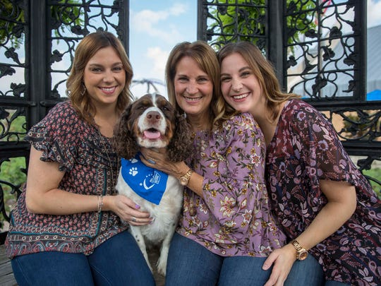 Heidi, Holly and Kendall Bryant sit with their dog Riley at Minnetrista Sept. 15. According to the Bryants, Riley has beena  source of comfort after Bill Bryant, Holly's husband and father of Heidi and Kendall, died from cancer in 2015.