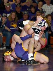 Northern Iowa's Logan Ryan, right, and Iowa State's