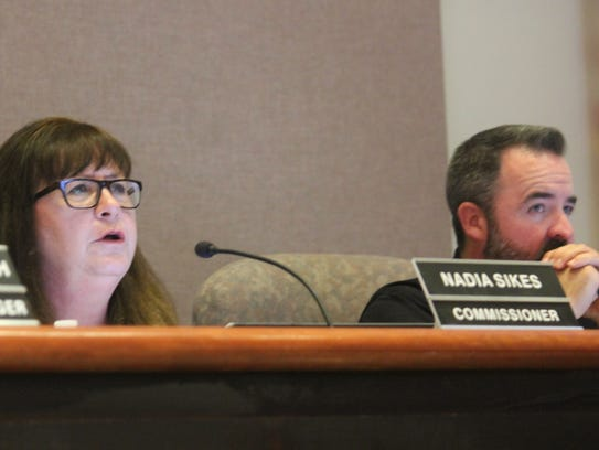 Commissioner Nadia Sikes, along with other commissioners,