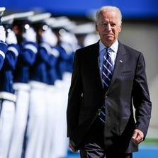 Vice President Biden walks to the stage during the graduation ceremony for the U.S. Air Force Academy class of 2014 at Falcon Stadium in Colorado Springs, Colo., on May 28, 2014.