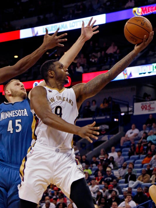 New Orleans Pelicans forward Terrence Jones, right, makes a layup against Minnesota Timberwolves center Cole Aldrich, left, during the second half of an NBA basketball game in New Orleans, Wednesday, Nov. 23, 2016. The Pelicans won 117-96. (AP Photo/Max Becherer)