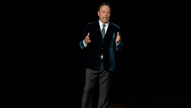 Billy Crystal speaks about Robin Williams during the 66th annual Emmy Awards at the Nokia Theater.