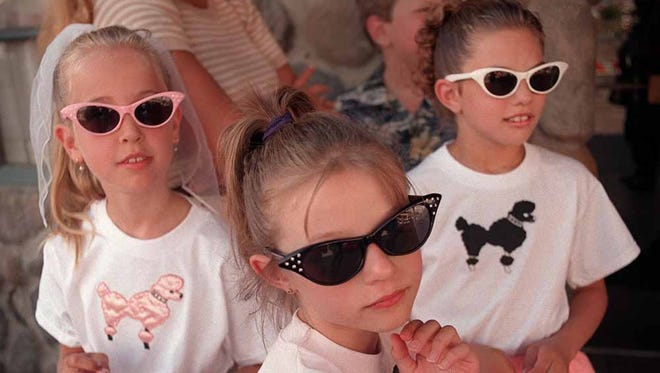 Taylor Previtt, left, and Brittany and Amanda Hayzlett of Portland, Ore., show their Hot August Nights mood during the event in 1999.