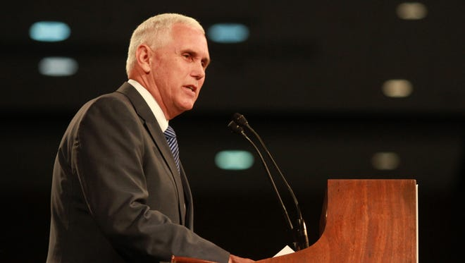 Indiana Gov. Mike Pence speaks during the Republican Party State Convention at the Grand Wayne Center, Fort Wayne, Ind., on June 7, 2014.