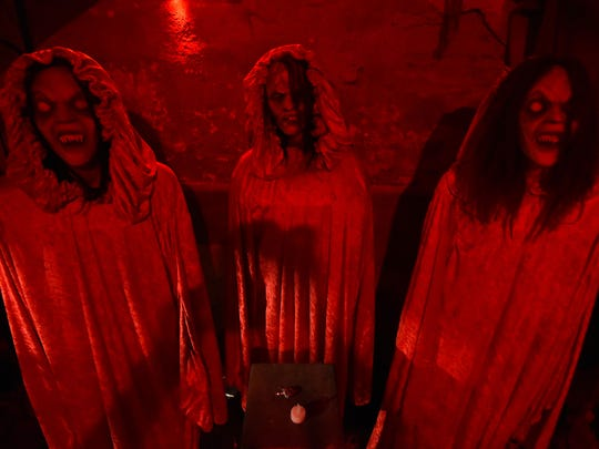A trio of frightning ladies greet guests to Escape from Blood Prison.