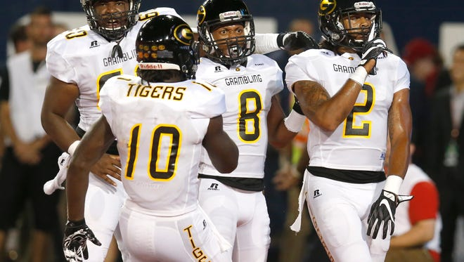 Grambling State wide receiver Verlan Hunter (2) celebrates with Dominique Leake after scoring during the first half of an NCAA college football game against Arizona, Saturday, Sept. 10, 2016, in Tucson, Ariz. (AP Photo/Rick Scuteri)