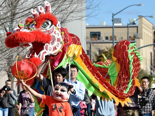 A dragon leads a parade down Pearl Street in Jackson during the 2016 Chinese Cultural Spring Festival.