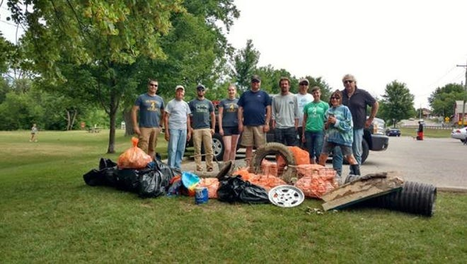 Volunteers from the Metro-West Steelheaders, the Clinton River Watershed Council and the Michigan United Conservation Club On the Ground program participated in a July 16 cleanup of the Clinton River.