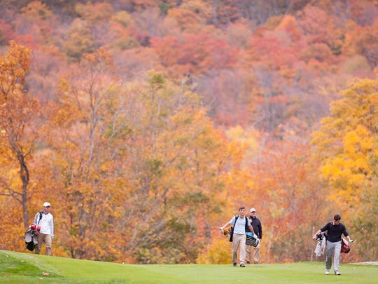 Players walk down the 12th fairway during the Vermont high school boys golf state championships on Wednesday at Green Mountain National Golf Course in Killington.