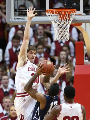 Indiana Hoosiers forward Collin Hartman goes up to stop Penn State Nittany Lions guard Geno Thorpe on a drive to the basket in the second half. Indiana hosted Penn State at Assembly Hall on Tuesday, January 13, 2015.