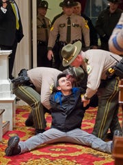 Single-payer protesters are arrested after refusing