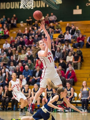 CVU'sLaurel Jaunich shoots over Essex's Alexis Britch during the girls D1 state basketball championship at Patrick Gymnasium in Burlington on Tuesday, March 10, 2015.