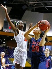 Brentwood Academy's Kallie Searcy (50) shoots  as Ensorth's Kaiya Wynn attempts to block during their game of the TSSAA Division II-AA basketball state championship at Lipscomb University  Saturday, March 3, 2018 in Nashville, Tenn. (Photo by Wade Payne, Special to the Tennessean)