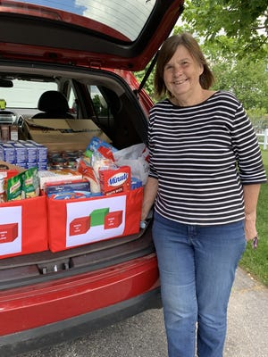 Somerset resident Sue Willen, founder of Boxes of Love, prepares to bring a donation to the food pantry.