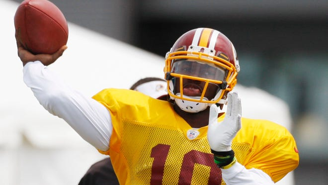 Redskins QB Robert Griffin III participated in his first 11-on-11 drills of the summer Aug. 14.