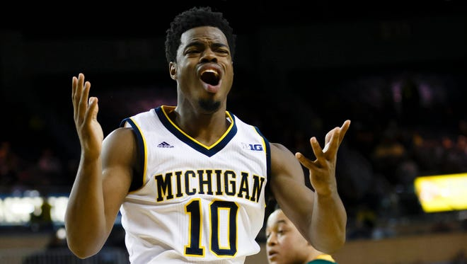 Michigan guard Derrick Walton Jr. reacts to a call in the first half against Northern Michigan at the Crisler Center.