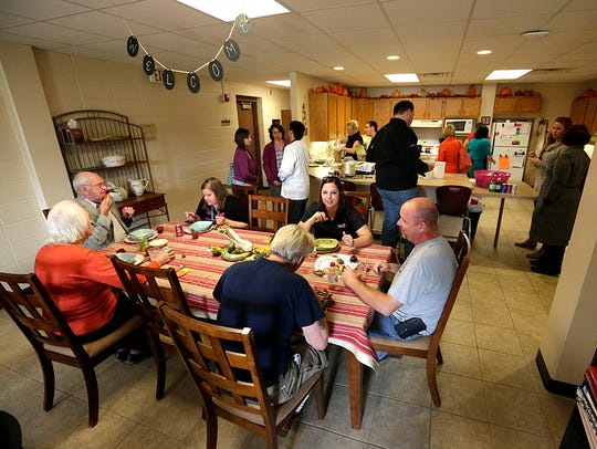 Diners eat soup in the W.I.N.G.S. classroom at Riverside